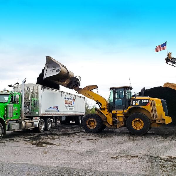 Loading Mulch into Semi Truck Trailer for Delivery